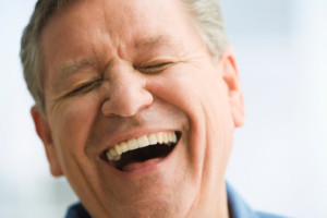 MAN LAUGHING IN THERAPY
